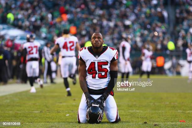 Middle linebacker Deion Jones of the Atlanta Falcons is seen on his knees before playing against the Philadelphia Eagles in the NFC Divisional...
