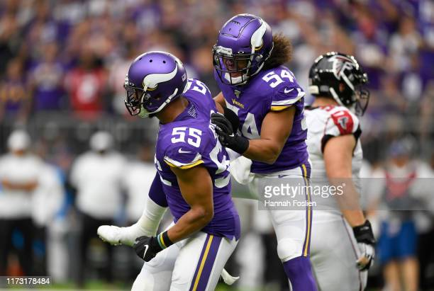Middle linebacker Eric Kendricks and teammate outside linebacker Anthony Barr of the Minnesota Vikings react against the Atlanta Falcons in the game...