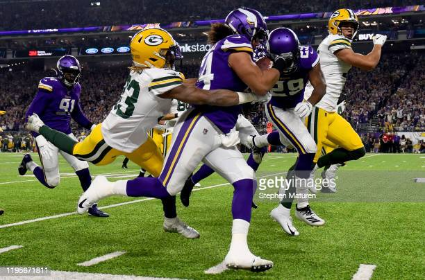 Middle linebacker Eric Kendricks of the Minnesota Vikings carries the ball after recovering a fumble by running back Aaron Jones of the Green Bay...