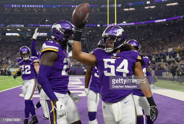Middle linebacker Eric Kendricks of the Minnesota Vikings celebrates with Jayron Kearse after recovering a fumble by running back Aaron Jones of the...