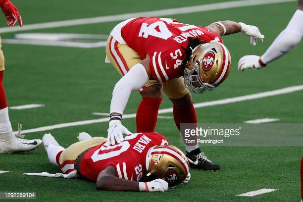 Middle linebacker Fred Warner calls out medical staff for free safety Jimmie Ward of the San Francisco 49ers after Ward after collided with wide...