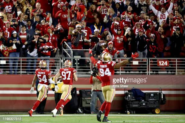 Middle linebacker Fred Warner of the San Francisco 49ers returns an interception 46 yards in the second quarter of the game against the Los Angeles...