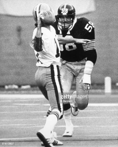 Middle linebacker Jack Lambert of the Pittsburgh Steelers eyes his target as he shadows the opposing quarterback during a game circa 19741984
