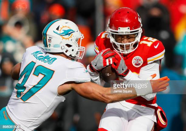Middle linebacker Kiko Alonso of the Miami Dolphins makes a tackle on wide receiver Albert Wilson of the Kansas City Chiefs during the first quarter...