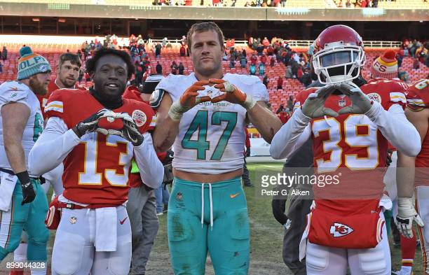 Middle linebacker Kiko Alonso of the Miami Dolphins poses for a photo with wide receiver De'Anthony Thomas and cornerback Terrance Mitchell of the...
