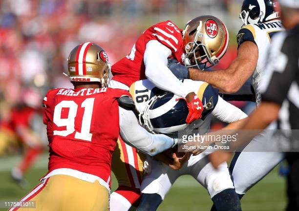 Middle linebacker Kwon Alexander and defensive end Arik Armstead of the San Francisco 49ers sack quarterback Jared Goff of the Los Angeles Rams in...