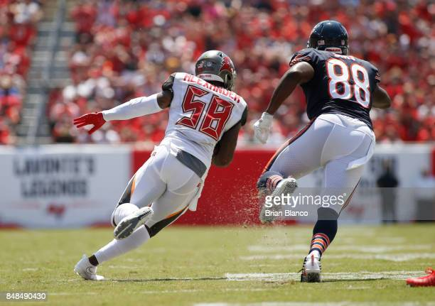 Middle linebacker Kwon Alexander of the Tampa Bay Buccaneers evades tight end Dion Sims of the Chicago Bears after intercepting a pass by quarterback...