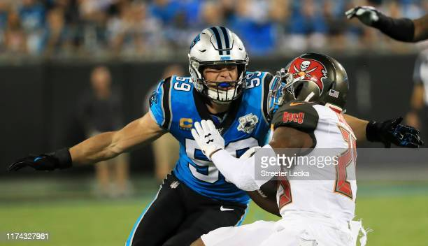 Middle linebacker Luke Kuechly of the Carolina Panthers tackles running back Peyton Barber of the Tampa Bay Buccaneers in the first quarter of the...