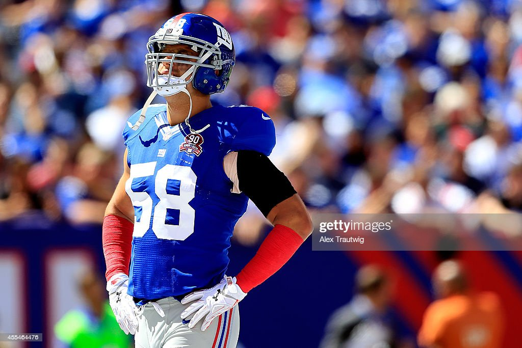 Middle linebacker Mark Herzlich #58 of the New York Giants looks on against the Arizona Cardinals during a game at MetLife Stadium on September 14, 2014 in East Rutherford, New Jersey.