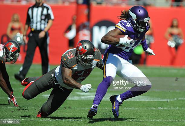 Middle linebacker Mason Foster of the Tampa Bay Buccaneers tackles wide receiver Cordarrelle Patterson of the Minnesota Vikings in the second quarter...