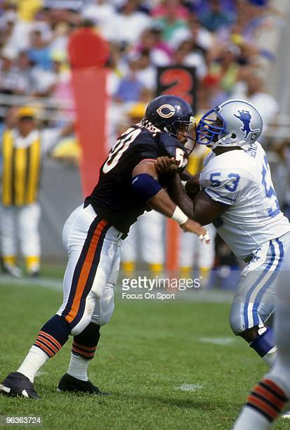 Middle Linebacker Mike Singletary of the Chicago Bears in action is blocked by Centre Kevin Glover of the Detroit Lions during a December 2 1990 NFL...