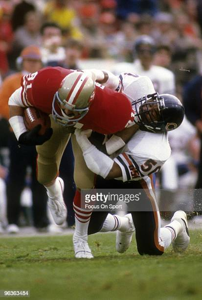 Middle Linebacker Mike Singletary of the Chicago Bears tackles tight end Russ Francis of the San Francisco 49ers January 6 1985 during the NFC...