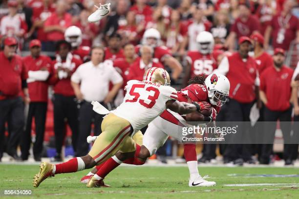 Middle linebacker NaVorro Bowman of the San Francisco 49ers tackles running back Andre Ellington of the Arizona Cardinals during overtime of the NFL...