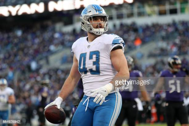 Middle Linebacker Nick Bellore of the Detroit Lions celebrates after scoring a touchdown in the fourth quarter against the Baltimore Ravens at M&T...