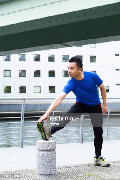 middle men preparing to exercise - achilles tendon stock pictures, royalty-free photos & images