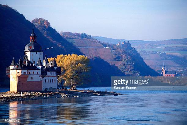 Middle Rhine Valley, Germany , in the background the romantic village OBERWESEL with the SCHOENBURG, used today as hotel, in the center of the village the gothic Liebfrauenkirche, Front: The Pheinpfalz located at the village KAUB