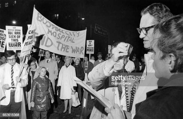 Middle right Dr Charles Janeway with Children's Hospital speaks to a group of hospital employees that marched from their various hospitals to Copley...