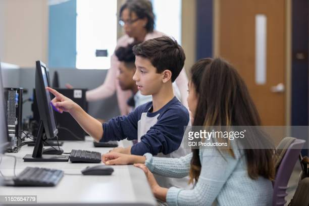 middle school friends in a computer lab - state school stock pictures, royalty-free photos & images