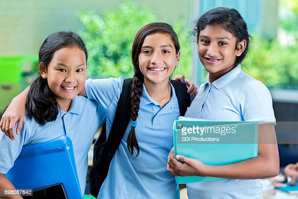 middle school friends on first day of school - charter_school stock pictures, royalty-free photos & images