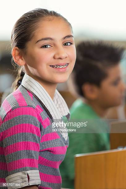 middle school student studying in library - beautiful girl smile braces vertical stock photos and pictures