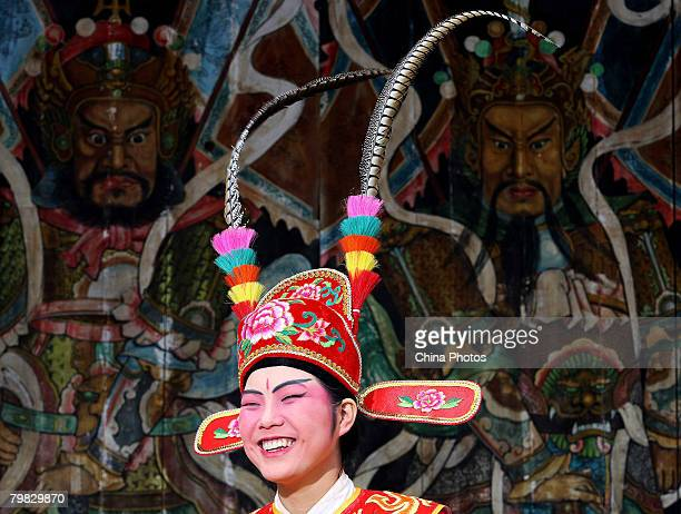 A middle school student who acts as the ancient Number One Scholar attends a parade to worship gods at Yun'ao Township on February 17 2008 in Nan'ao...