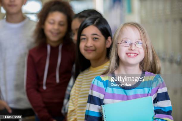 middle school students in hallway - charter_school stock pictures, royalty-free photos & images