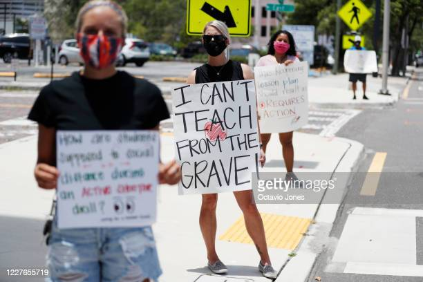 Middle school teacher Brittany Myers, stands in protest in front of the Hillsborough County Schools District Office on July 16, 2020 in Tampa,...