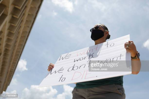 Middle school teacher Danielle Weigand stands in protest in front of the Hillsborough County Schools District Office on July 16 2020 in Tampa Florida...
