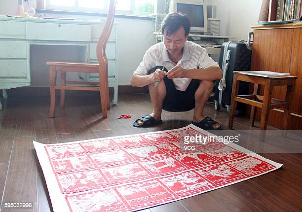 Middle school teacher Zhang Weiyong makes paper cut of G20 cities on August 25 2016 in Tonglu County Hangzhou City Zhejiang Province of China...