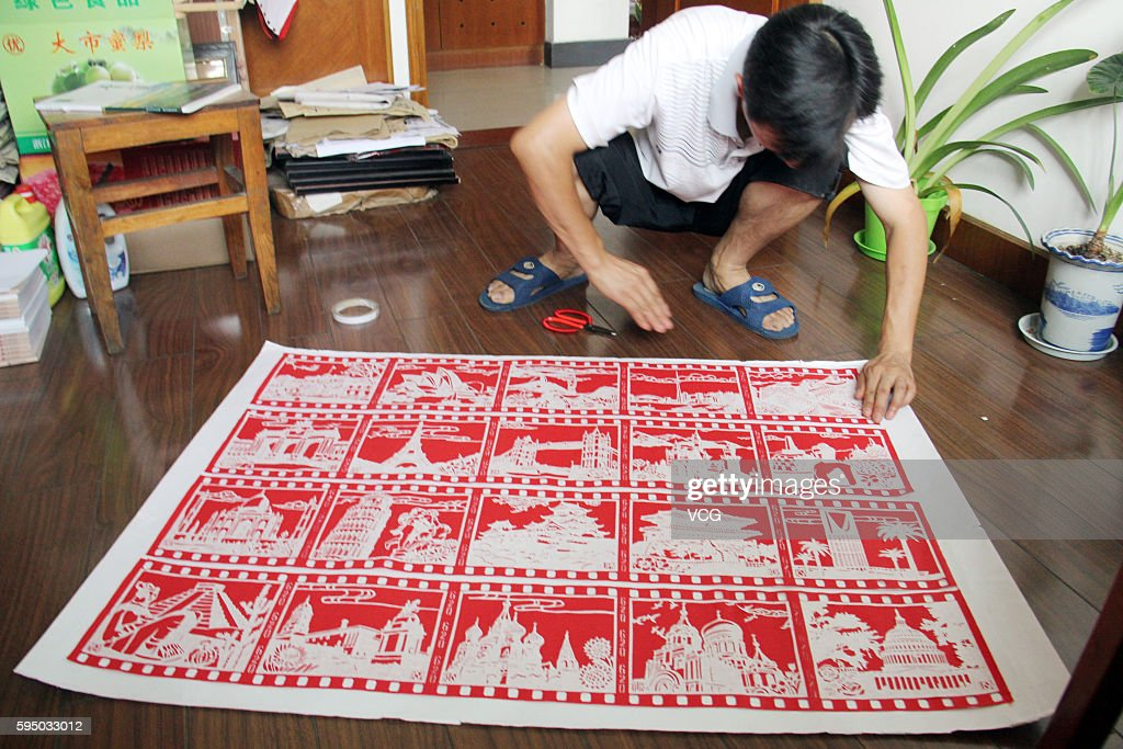 Middle school teacher Zhang Weiyong makes paper cut of G20 cities on August 25, 2016 in Tonglu County, Hangzhou City, Zhejiang Province of China. Fuchunjiang Middle School teacher Zhang Weiyong spent nearly 2 months to make the paper cut of G20 cities to cheer for the upcoming G20 Summit in Hangzhou.