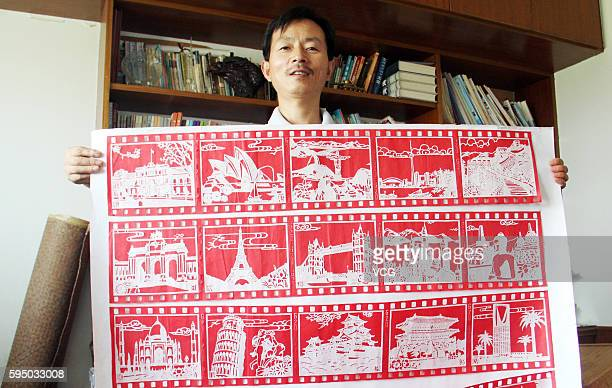 Middle school teacher Zhang Weiyong shows his paper cut of G20 cities on August 25 2016 in Tonglu County Hangzhou City Zhejiang Province of China...