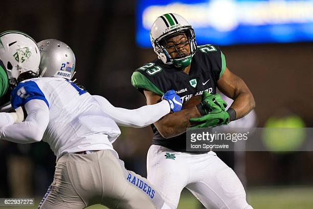 Middle Tennessee Blue Raiders CB Charvarius Ward fights off a block as he reaches out to make a tackle on Marshall Thundering Herd RB Tony Pittman...