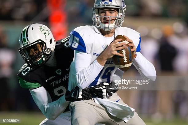 Middle Tennessee Blue Raiders QB John Urzua is sacked by Marshall Thundering Herd DL Damien Dozier during the third quarter of the quarter of the...