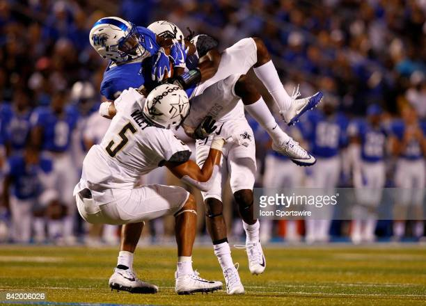 Middle Tennessee Blue Raiders wide receiver Richie James gets tackled by Vanderbilt Commodores safety LaDarius Wiley and cornerback Tre Herndon after...