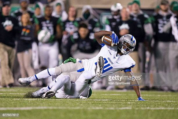 Middle Tennessee Blue Raiders WR Ty Lee is tackled by Marshall Thundering Herd S Corey Neely after making a catch during the second quarter of the...