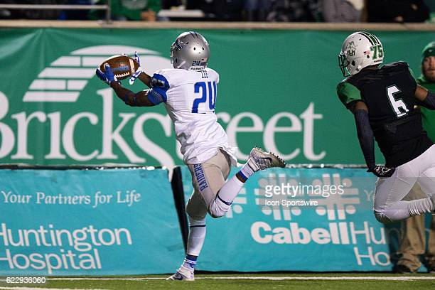 Middle Tennessee Blue Raiders WR Ty Lee makes a catch and keeps his feet in bounds as Marshall Thundering Herd DB Terry Richardson defends during the...