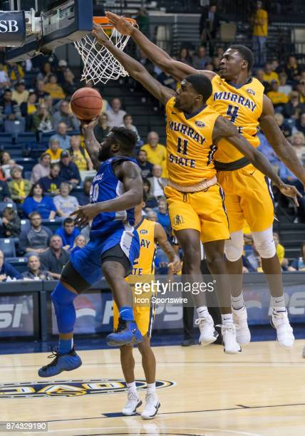 Middle Tennessee guard Giddy Potts puts up a layup while being covered by Murray State guard Leroy Shaq Buchanan and Murray State forward Brion...