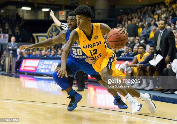 Middle Tennessee guard Giddy Potts reaches in on Murray State guard Temetrius Ja Morant as he drives to the basket during the college basketball game...