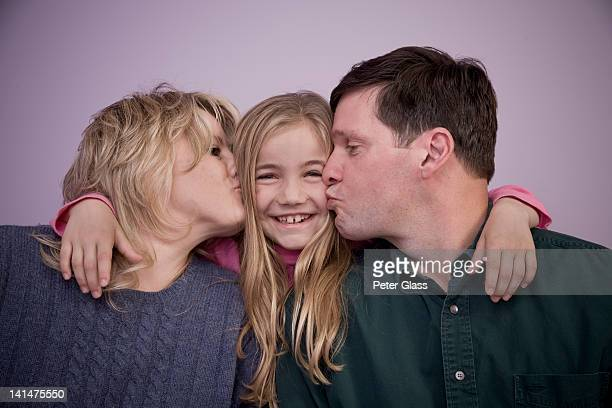 middle-age couple with their young daughter. - femme entre deux hommes photos et images de collection