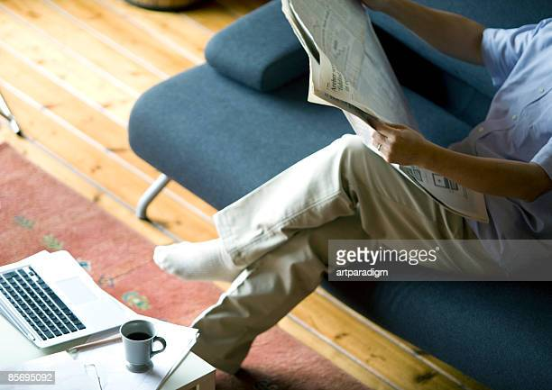 Middleage man reading newspaper