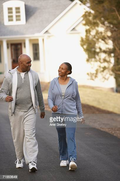 Middle-aged African American couple walking