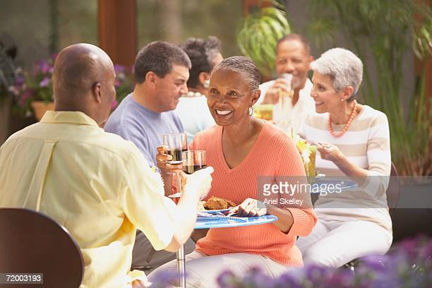 Middle-aged African couple at outdoor restaurant