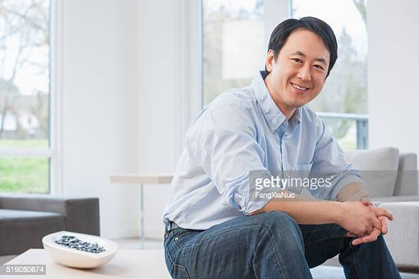 Middle-aged Asian man in living room