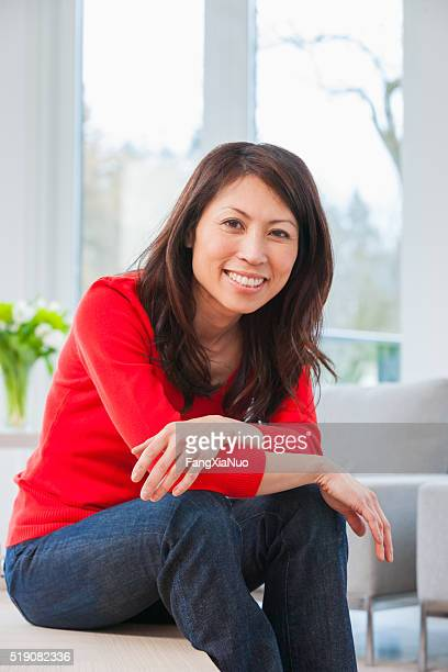 Middle-aged Asian woman in living room