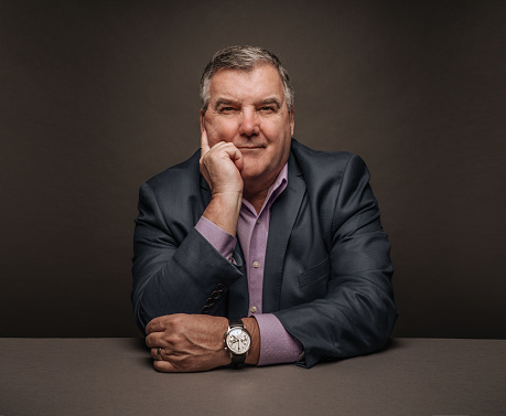 Middle-aged Businessman on dark background - gettyimageskorea