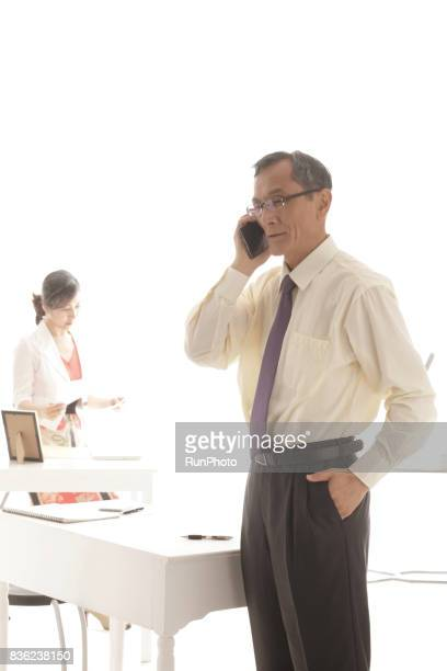 middle-aged businessman who is calling with a smart phone