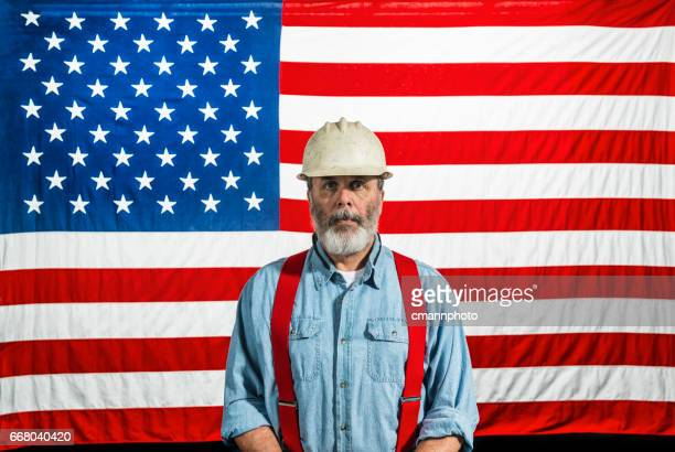Middle-aged construction worker portrait in front of a US flag