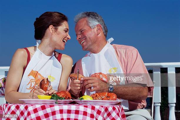 Middle-aged Couple Eating Lobster