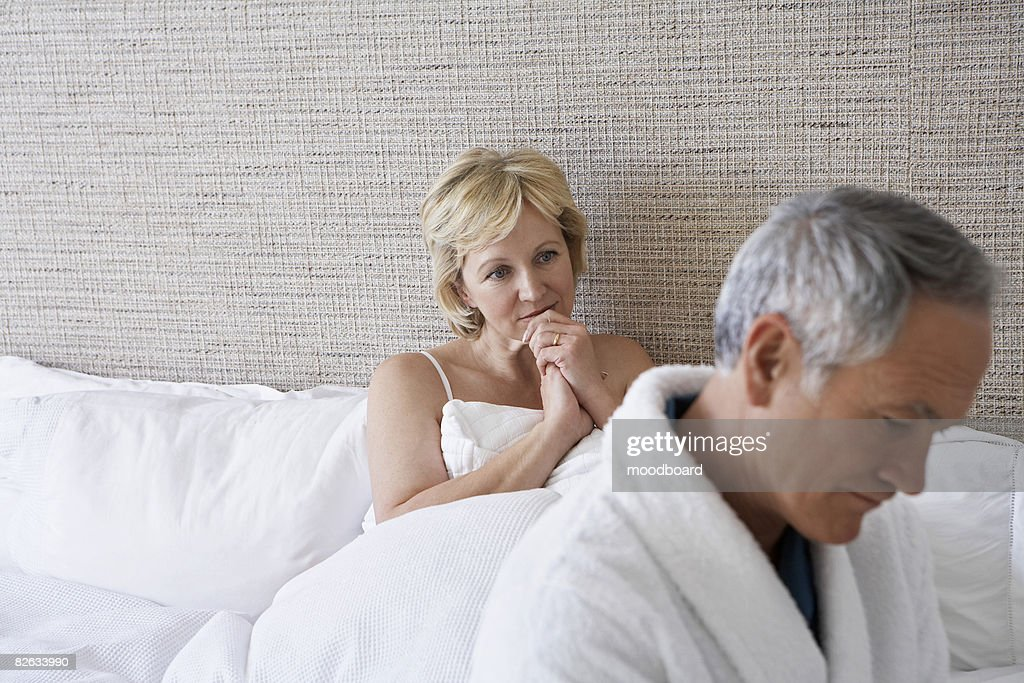 Middle-aged couple in bedroom : Stock Photo