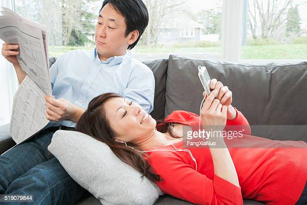 Middle-aged couple relaxing on sofa